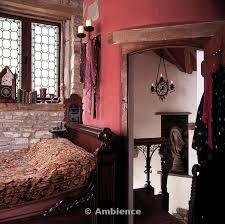 Dark Pink Bedroom - ambience images mahogany single bed between window and open door