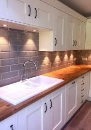 copper backsplash tiles kitchen surfaces pinterest our edge grigio tiles look lovely in a cream kitchen with wooden