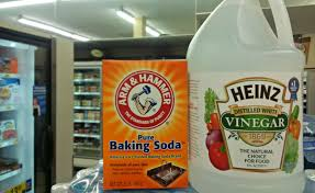 plumbing tips and advice angies list box of baking soda and a bottle of vinegar
