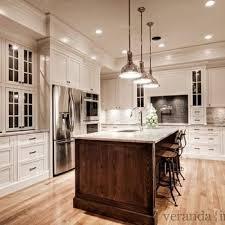 white kitchen cabinets with colored island white granite countertops transitional kitchen