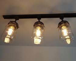 Beautiful Track Lighting by A Mason Jar Track Light Of 3 Vintage Quarts U2013 The Lamp Goods