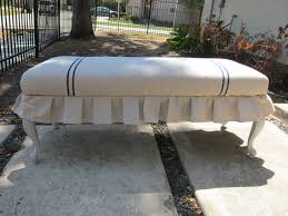 white slip cover on repurposed bench with simple fence near big