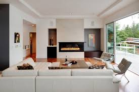 harwood floors in modern living room with a fireplace and