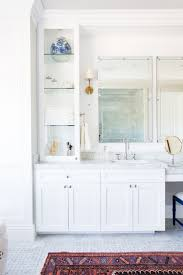 Bathroom Sconces White Bathroom Cabinetry Brass Sconces Marble Floors Studio