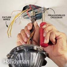 Wiring A Ceiling Light How To Hang A Ceiling Light Fixture Family Handyman