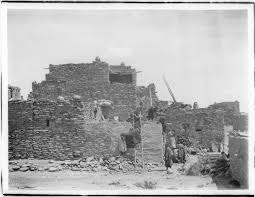 file a group of hopi indian women building an adobe house in the