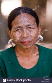 chin tribal woman with spider web design tattooed face myanmar