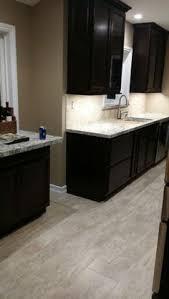 espresso cabinets dark hardwood floors alaskan white granite