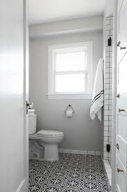 bathroom with black and white cement floor tiles view full size
