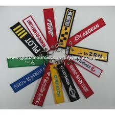 china custom embroidered keychains for custom made logos on global