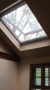 installation of velux skylights for interior design with wall
