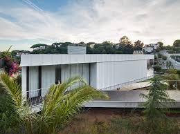 100 hillside house plans with garage underneath island