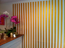 how to paint an awesome gold and white stripe wall bloomin u0027 buckets