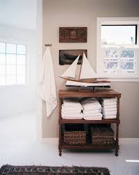 furniture nautical themed bathroom with white tile floors