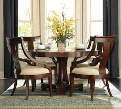 dining round pedestal dining table with grey window curtain and