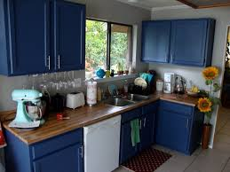 incredible blue kitchen cabinets with white painted wall and