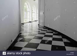 white art deco hall with black and white floor tiles stock photo