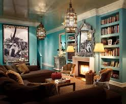 family room with blue walls and fireplace also moroccan lights