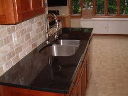dark stone backsplash luxury kitchen style with brown tumbled stone tile backsplash