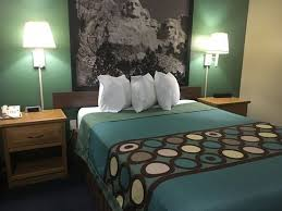 good space around bed outlets on one nightstand clock on the
