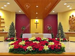 altar decorations a church altar decorated with flowers on christmas day stock
