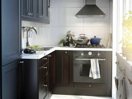 small fitted kitchen ideas masculine micro kitchen remodel black cabinetry white wall