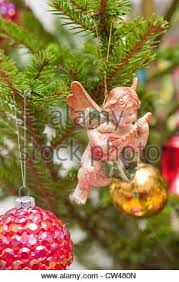 Decoration In Christmas by Cherub Christmas Tree Decoration Playing Violin Stock Photo