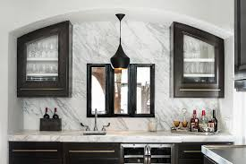 Black Cabinets White Countertops Black Cabinets With Brass Pulls And White Marble Countertops