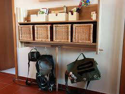 upgraded ikea skogsta wall shelf with bag hangers ikea hackers