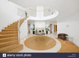 a circular entrance hall with double height vaulted ceilings and a
