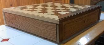 board game storage cabinet chess board with piece storage by kcoombs lumberjocks com