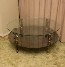 vintage glass top coffee table with cherub motif ebth