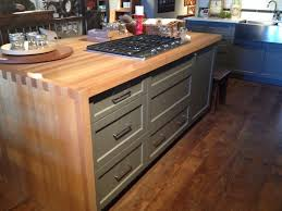 love this butcher block waterfall counter on the island which is