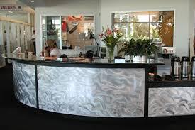 brushed aluminum curved reception desk custom for auto dealer