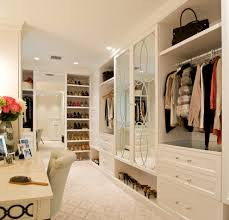 dressing room closet transitional with crown molding neutral colors