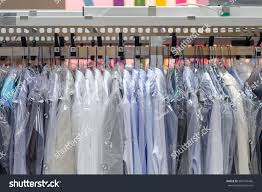 Laundry Room Hangers - clean clothes on hangers laundry room stock photo 383124436