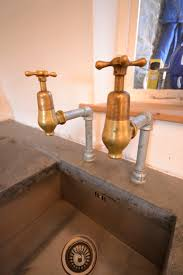 Beautiful Reclaimed Brass Globe Taps Finish Off The Look Of This - Brass kitchen sink