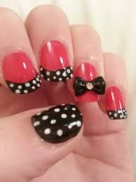 red nail design with bows and then add your bow add a dot of top