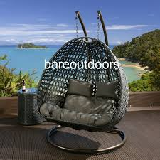 double seater hanging pod chair black grey cushions bare outdoor ik