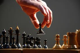 hand moving the pieces of a chess board close up 607873477 58863b643df78c2ccda1778d jpg