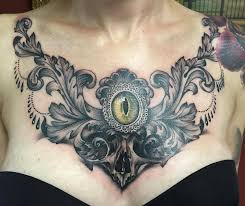 chest in black and grey with skull and eye by