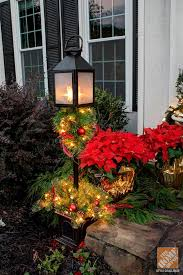 Christmas Decoration For Front Door by Holiday Door Decorating Ideas For Your Small Porch The Home Depot