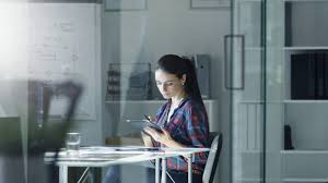 female design engineer sits at the glass table in her office