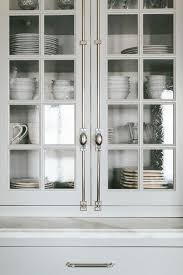 seeded glass kitchen cabinet doors white and gray kitchen features floor to ceiling glass
