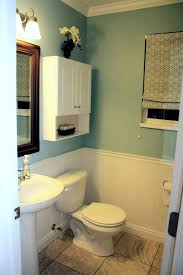 bathroom unique color combination between blue oval window frame