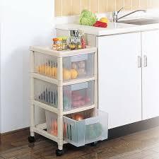 vegetable storage kitchen cabinets buy japan imported kitchen storage box storage drive pulley
