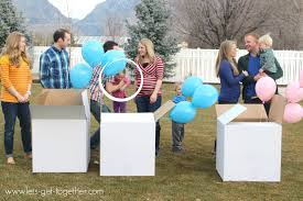 balloons in a box gender reveal a big announcement times three