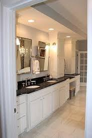 White Bathroom Vanity With Black Granite Top - the master bathroom has black granite countertops with double