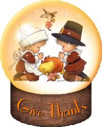 thanksgiving snow globe praying pilgrim children animated gif
