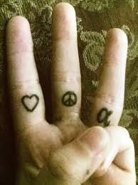 finger tattoo peace grey ink small heart and peace sign tattoo on inner finger